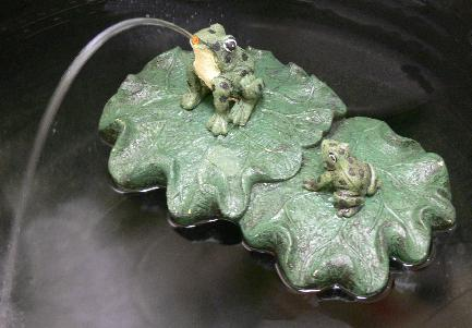 frog on floating lotus water fountain